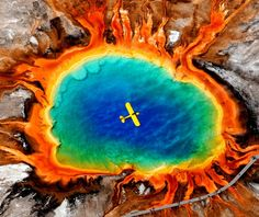 photographer Larry Mayer's image of a small plane flying over Grand Prismatic Spring in Yellowstone National Park was named 2010 Photo of the Year by the Montana Newspaper Association.
