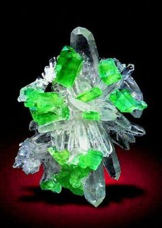 This is a star-shaped quartz cluster with brilliant augelite crystals distributed between the quartz. From Mundo Nuevo Mine, Sanchez Carrion, La Libertad, Peru.  Credit: Rudolf Watzl  Geology Wonders