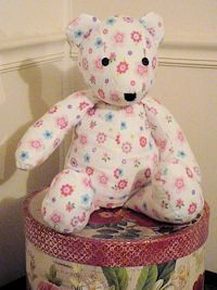 Memory bear made from a receiving blanket. Can also be made from a men's button down dress shirt, baby blanket, baby clothes, a dress, etc. The possibilities are endless.