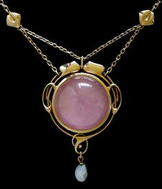 Possibly designed by Archibald KnoxA gold locket pendant set with pink quartz and a pearl drop. Murrle Bennett & Co., ca. 1900.