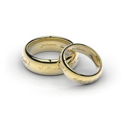 LOTR Wedding rings  One ring to show our love, One ring to bind us,  One ring to seal our love, And forever to entwine us.