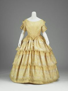 Evening dress, silk taffeta with brocaded border pattern, c. 1855, possibly French.