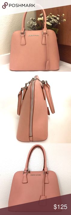 """Adrienne Vittadini City Slicker Dome Satchel Brand new with tags. Be the epitome of sophistication carrying this gorgeous Dome Satchel by Adrienne Vittadini in a chic blush color. Crafted in beautiful faux leather. The bag is fully lined and features an all round zipper, one main compartment, interior accessory pockets and signature zippers. Dimensions: 11""""W X 14""""H X 6""""D. Comes from a smoke free home. Reasonable offers will be accepted Adrienne Vittadini Bags Satchels"""