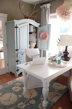 Clever idea to use a hutch painted in a home office.  How fun in a pop of yellow paint!