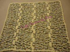 Beige/brown bernat baby blanket