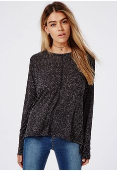 Keep you wardrobe staples up to date with this long sleeve jersey. The black marl with white speckles in soft jersey create a super chic top you can team with all of your basic pieces to create a laid back look. Team with skinny jeans and a...