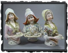 "HALF DOLLS: November 2011 ""These 3 serving sisters are made by Galluba & Hofmann. The ladies on the left & right side are not as rare as their sister in the middle in a winged Dutch cap. Her sisters are holding trays with a cup and water glass.  They are marked with an incised 9198, 3867 and 9190. Size is about 13 cm."""