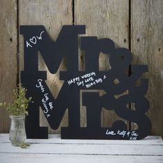 A chalkboard Mr & Mrs guest book alternative. Your guests write their names and messages on the chalkboard with a coloured pen or chalk (not supplied). After your reception it can be hung around the house as a keepsake from your special day. Chalkboard Wedding, Chalkboard Signs, Mr Mrs Sign, Wedding Guest Book Alternatives, Wedding Keepsakes, Book Signing, Wedding Book, Wedding Favours, Table Centerpieces