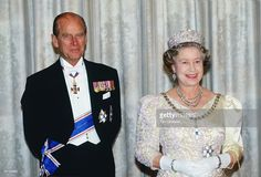 Queen Elizabeth II and Prince Philip attend a banquet during a visit to iceland.