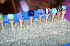 Montessori Idea to balance marbles on golf tees for balance and fine motor skills