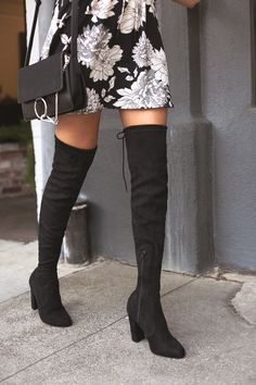 """We are absolutely, positively obsessed with the So Much Yes Black Suede Over the Knee Boots! These trendy vegan suede boots have a 26"""" over-the-knee shaft and a tying collar with a 15"""" circumference. 9.5"""" zipper at the instep."""