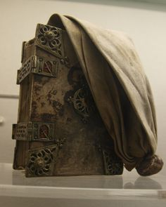 German girdle book dating from 1471. Girdle books were small portable books with a loose binding allowing them to be tied to one's girdle for convenience and show.