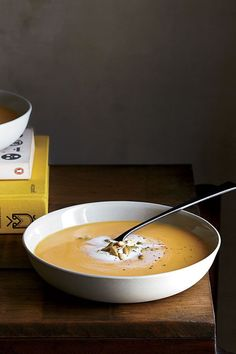 This quick and easy 45-minute squash soup recipe incorporates onions, garlic, squash puree, nutmeg, pumpkin ice cream and pumpkin seeds to create the ultimate comfort food meets fall recipe. Whether you're eating this squash recipe as a quick and easy weeknight dinner or packing it up for a lunch, it's a great choice for a fall recipe.#squashsoup #souprecipes #squashrecipes #fallrecipes #comfortfood