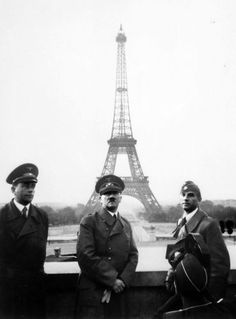 """Taken a day after the signing of the Franco-German armistice in France, Adolf Hilter poses in front of the Eiffel Tower with """"Architect of the Reich"""" Albert Speer (left) and Arno Breker."""