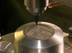 Engraving dies ensure crisp detail in coins. Here, a Royal Mint die displays part of the Shield of the Royal Arms.
