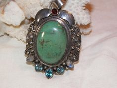 Vintage sterling silver southwestern style pendant with garnet moonstone turquoise and blue topaz. by MerakiByMe on Etsy