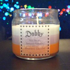 Dobby scented 4oz candle: new socks, sugared violets, and the hogwarts kitchens. >>> No. It smells like tears.