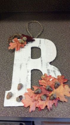 Wooden letter from Hobby Lobby, crackle paint, artificial leaves and acorns. Fabulous fall door decor for less than $10!