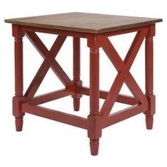 """Weathered end table in red with an openwork base and turned legs.      Product: End tableConstruction Material: MDF and solid woodColor: RedFeatures:   Turned wood legs and cross beamsAntique style Dimensions: 24"""" H x 22"""" W x 23.75"""" D"""