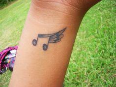 Tatuagens Femininas de Música