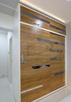 Two door sliding wooden 👕 wardrobe with concealed handles and two fixed storage drawers on the upper level - GharPedia Wardrobe Laminate Design, Wall Wardrobe Design, Wardrobe Interior Design, Bedroom Cupboard Designs, Bedroom Closet Design, Bedroom Furniture Design, Home Room Design, Bedroom Ideas, Sliding Door Wardrobe Designs