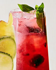 We love the bright raspberry color of this refreshing cooler. Infused with fresh herbs, citrus, and berries, this not-too-sweet pour is as invigorating as a cannonball in the deep end. #marthastewart #mocktails #summerdrinks