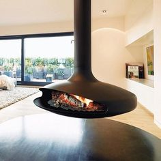 Focus fireplaces present Gyrofocus, a sustainable energy source for restaurants, hotels, and homes. Suspended Fireplace, Floating Fireplace, Hanging Fireplace, Focus Fireplaces, Cabin Style Homes, Simple Floor Plans, Renewable Sources Of Energy, Fireplace Design, Painting On Wood