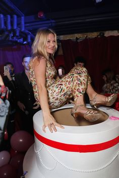 Kate Moss channelled Marilyn Monroe and jumped out of a cake - HarpersBAZAARUK