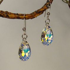 @Overstock - Stunning Swarovski crystal pendants light up the room with their breathtaking beauty and precision-cut facets that create showers of light reflections. These 16 mm drops are hung on .925 sterling silver french hook earwires.http://www.overstock.com/Main-Street-Revolution/Jewelry-by-Dawn-Sterling-Silver-Crystal-AB-Pear-Earrings/6816296/product.html?CID=214117 $14.99