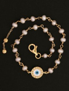 Gold and Pearl Evil Eye Bracelet at London Jewelers!