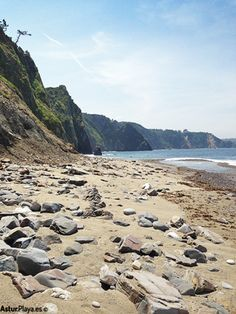 Eastern side of the Ballota beach in Cudillero, Asturias, Spain. A secluded nudist beach accessible on foot only.