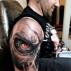 realistic red eye tattoo