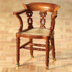 Dicken's writing chair. The seat is more orange and less detailed than it looks in the catalogue pictures but I still love it! I love the working castors, the carvings, the shape and all the delicate turnings!