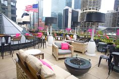"It's So Miami Lounge: On Saturday, the Greater Miami Convention & Visitors Bureau invited artists, media, and V.I.P. guests to an off-site brunch at the ""It's So Miami Lounge."" The activation took over Raised, a new, rooftop bar at Renaissance Chicago Downtown Hotel. Bright-pink pillows with Miami branding decked the furniture, while plastic flamingos spruced up the flower boxes. BMF Media produced the event."