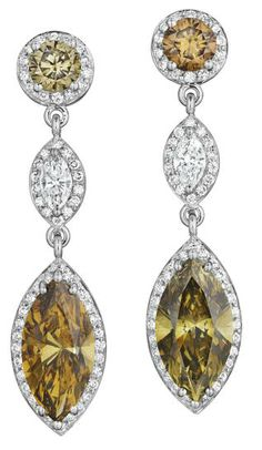 A Pair of Colored Diamond and Diamond Ear Pendants.       Each suspending a marquise-cut brown diamond, within a pavé-set diamond surround, to the similarly set marquise-cut white diamond link and brown diamond surmount, mounted in 18K white gold, length 1 1/2 inches. Philips de Pury.