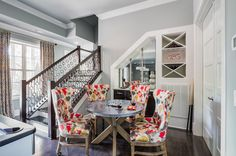 Love this stair railing... Unexpected, fun, modern, stylish fabric on traditional chairs transitional basement by Eric Ross Interiors, LLC
