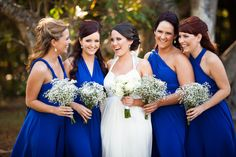 Bride with bridesmaids - Noosa Waterfront Wedding. I love the styles of the bridesmaid dresses.*