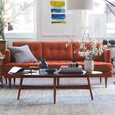 Traditional meets modern. The Peggy Sofa combines clean, classic lines with retro details, like tufted back and seat cushions and tapering pecan-stained solid wood legs.