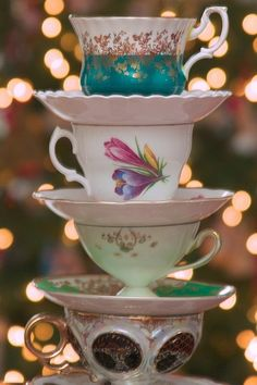 Idea for a vintage baby shower - Goodwill some assorted tea cups and stack them with a little tea in them for effect!