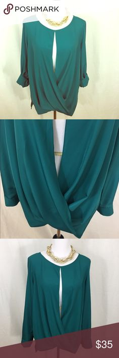 Beautiful Michael Kors blouse Beautiful open front faux wrap teal blouse. Super stylish flowy material . Sleeves can be worn rolled or down. MK on buttons. In excellent condition. Size Large(fits 12-14) because of design. Michael Kors Tops Blouses