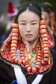 The leader of the maiden's dance group at the Repkong Shaman Festival in Repkong, Amdo, China