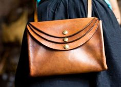 Nice play on the leather, not as much hardware as I usually like, but it's simple and that's nice