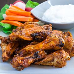 Buffalo Chicken Wings - baked not fried! And this recipe could not get any easier! This is the one for playoff Sunday