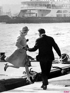 Queen Elizabeth jumps from a barge onto the dock during a state visit to Turkey in October 1971. - Imgur