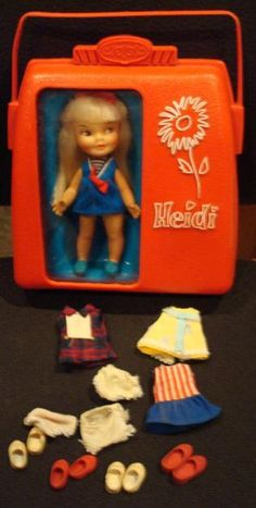 Heidi doll.....I loved this little doll. Her hand raised up to wave 'hello' when you pushed the button on her belly.
