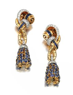 PAIR OF SAPPHIRE AND DIAMOND PENDENT EAR CLIPS, BOUCHERON, 1940S.  Each of scroll and tassel design set with circular- and calibré-cut sapphires and single-cut diamonds, signed Boucheron, Paris, stamped with French assay and maker's marks, clip fittings, one diamond deficient.