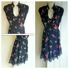 """Flirty Dress Ruffles on top.and bottom. Asymmetrical cut at the bottom. Longest part is 40"""", shortest is 35"""" long. Zipper at the side, lined. Armpit to armpit measured flat 18"""". Belt included :). Cotton and Polyester. Size M. (8-10). Black, with red roses/flowers print. Dresses Mini"""