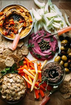 """A selection of delicious vegan spreads for parties. Cashew """"cheese"""" with beetroot & miso, mushroom & olive pâté, and roasted butternut & garlic spread."""