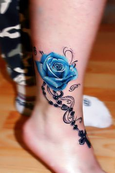 tattoos on back of ankle / tattoos on back ; tattoos on back of arm ; tattoos on back for women ; tattoos on back of neck ; tattoos on back shoulder ; tattoos on back of ankle ; tattoos on back of leg ; tattoos on back of arm above elbow 3d Rose Tattoo, Rose Tattoo On Ankle, Blue Rose Tattoos, Blue Tattoo, Tattoo Flowers, Butterfly Tattoos, Flower Henna, Feather Ankle Tattoos, Tattoos Of Roses