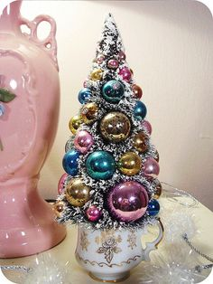 Christmas ornament bottle brush tree in tea cup.